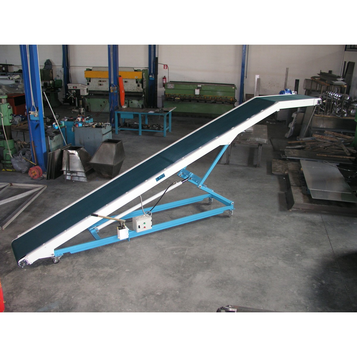 Conveyor for top loading
